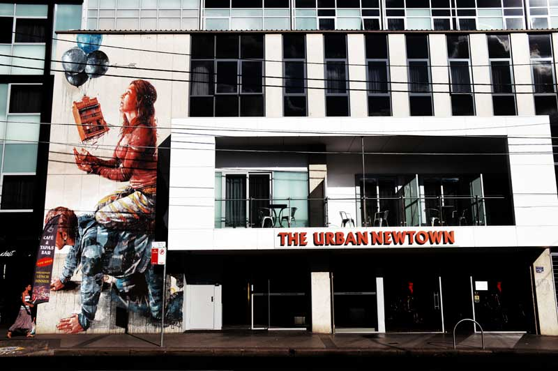 the urban newtown sydney hotel photographed from outside with wall art