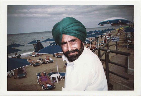 dirty photos - on the island of - photo of indian man with head top at the beach