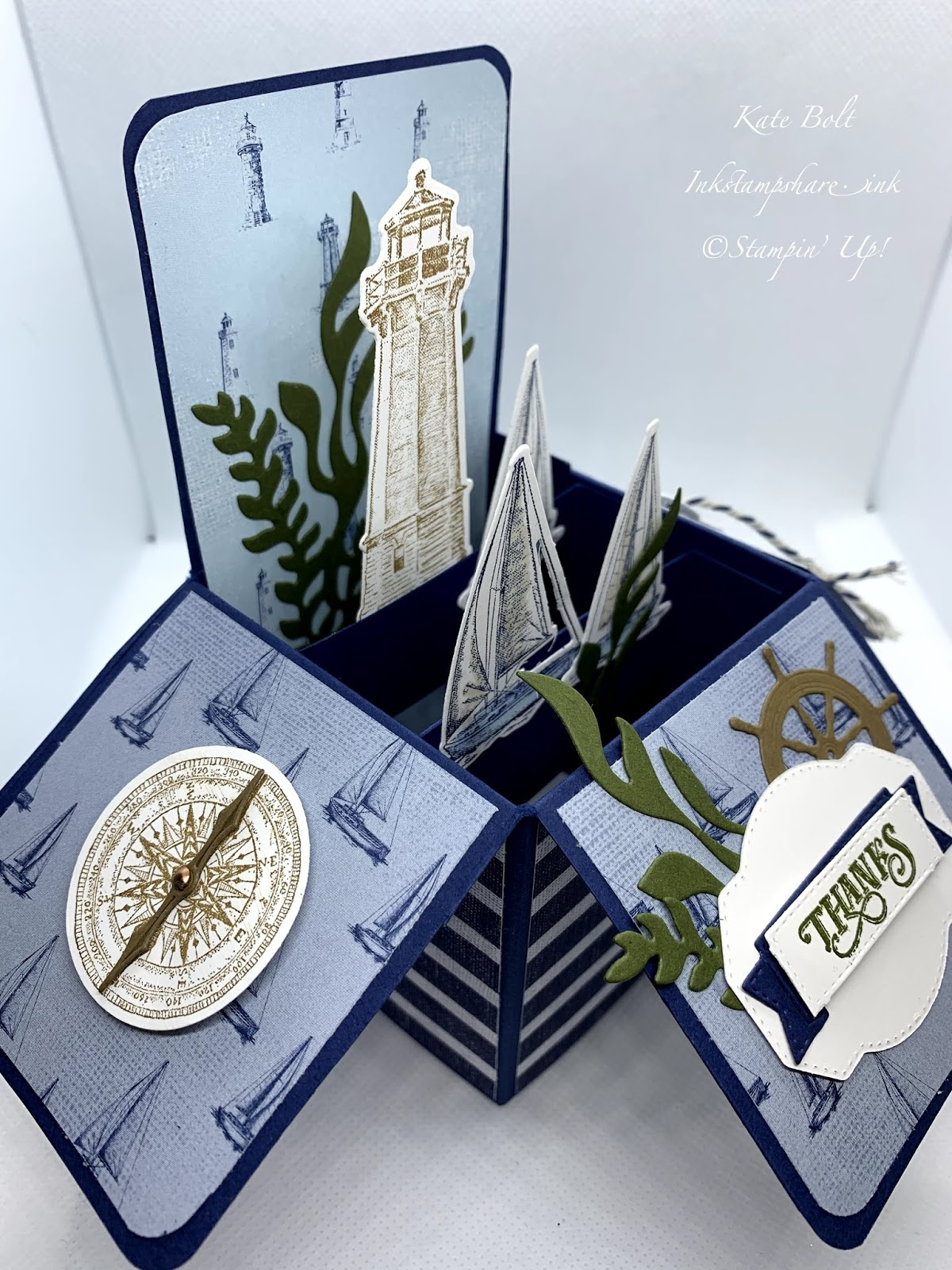 This is the side view of a card in a box with boats, light house, anchor, compass and seaweed, using the Lets Sail Away stamps, dies and paper from Stampin Up