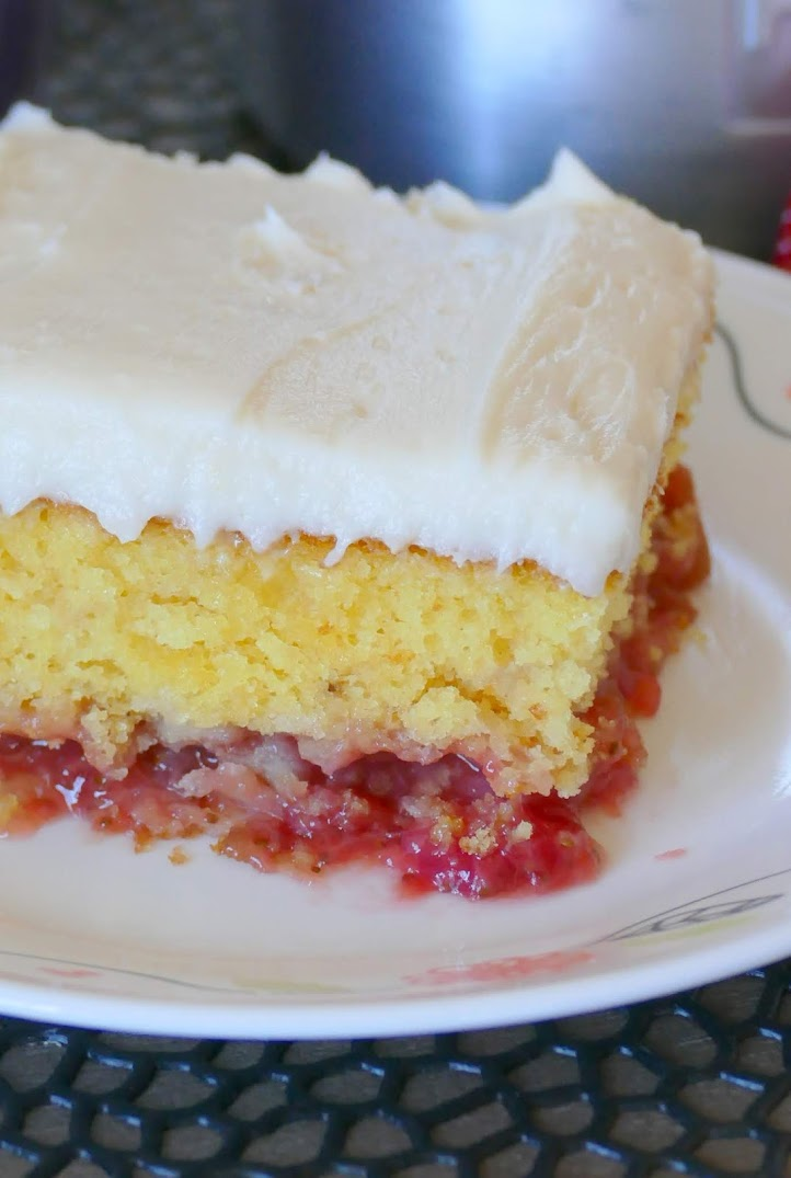 This spring and summer dessert is wonderful for any occasion. The rhubarb and strawberry layer is delicious with the cake and homemade buttercream frosting! This is a crowd pleaser and true family favorite! Use fresh or frozen rhubarb!