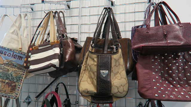 Image: Handbags at the local thrift store. Tangie is shopping while sharing fun, weird and embarrassing things about herself