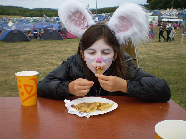 girls in fancy dress eating pancake