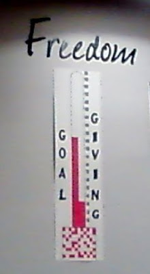 Freedom thermometer wall of giving