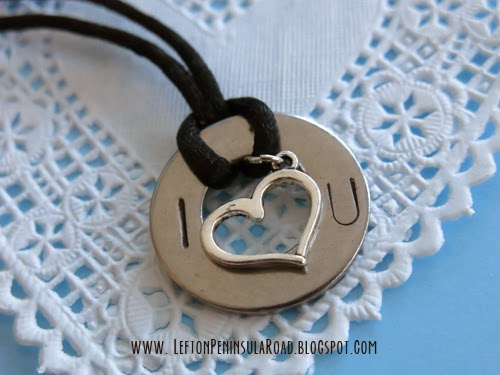 Stamped Valentine's Washer Pendant displayed on a lace doily.