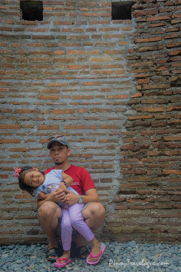 Me and my daughter between the original and restored walls of Baluarte