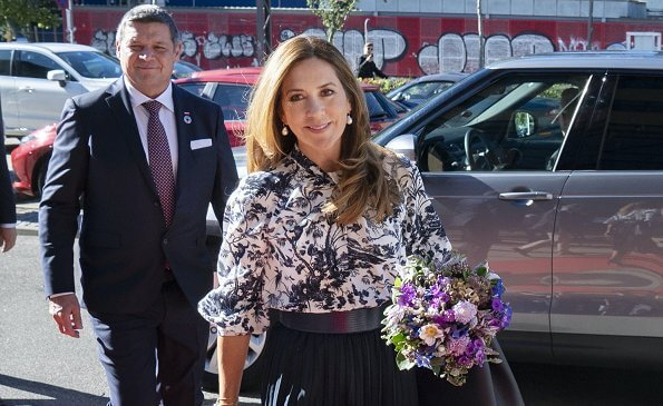 Crown Princess Mary wore a new Arlette printed crepe de chine blouse from Erdem. Gianvito Rossi purple pumps, pleated midi skirt