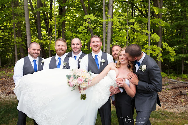 groomsmen lifting bride at Noah's Event Venue in Auburn Hills Michigan