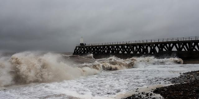Photo of waves crashing onto the beach at Maryport