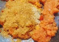 Adding masala powder for chole(chickpeas) recipe