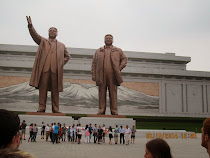 Massive 22 meter statues of Kim Il-sung and Kim Jong-il in front of Kimsusan Memorial Palace