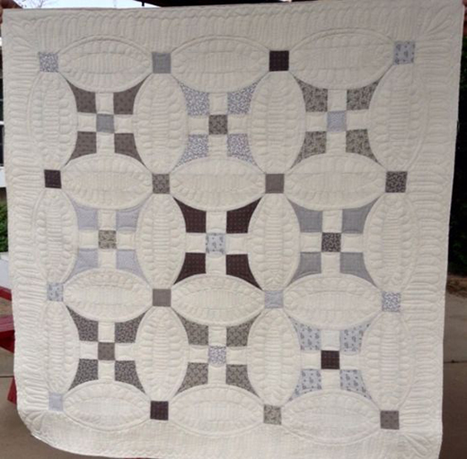 Glorified Nine-Patch Wall Hanging Inspired by Embrace Your Curves from designer Becky Cogan for Need'l Love,