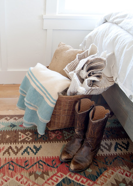 Farmhouse Master Bedroom Reveal - basket, wool blanket, boots