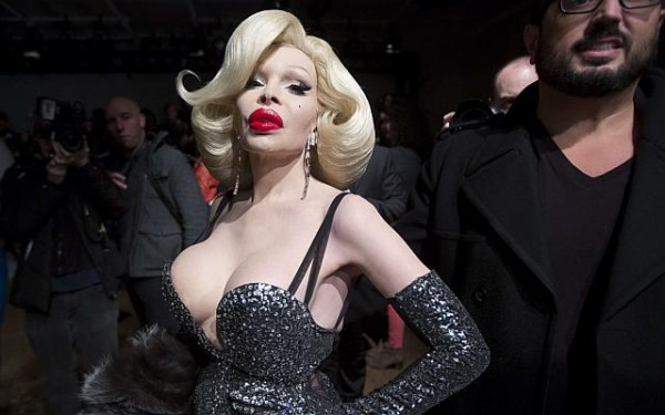 Amanda Lepore. Amanda Lepore, born Armand Lepore, is a famous American model, nightlife and fashion icon. She has served as a muse for photographer David LaChapelle's work, and is best remembered for appearing in advertisements for M.A.C Cosmetics and fashion brand Heatherette. She underwent gender reassignment surgery at age 19 in New York in 1989. In the 1990s, she established her career as a nightlife figure. Photo: Reuters