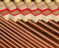 dampers on bass strings in an acoustic piano
