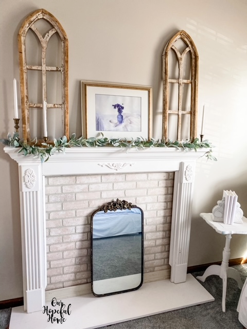 white faux mantel gold frame arch decor