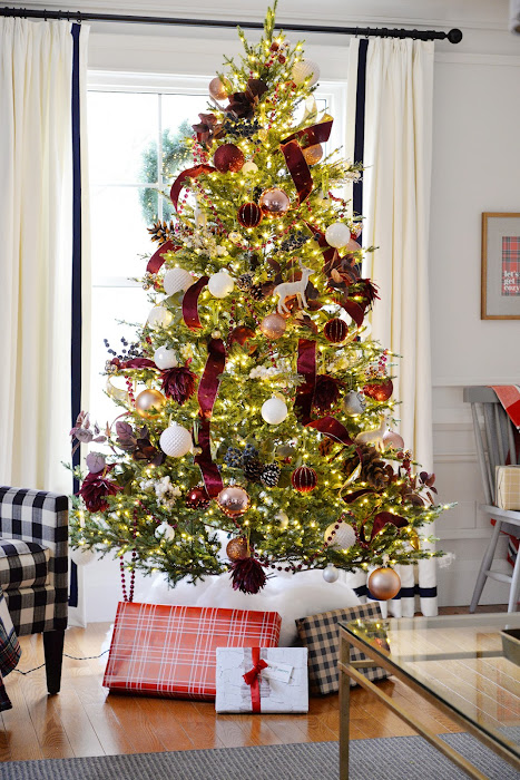 LED Christmas tree, faux fir Christmas tree. Red and white Christmas tree decorations.