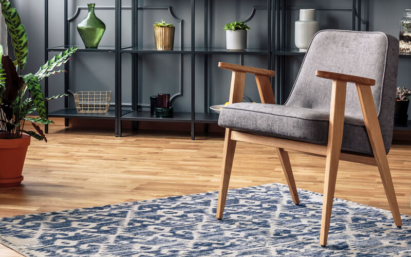 You can add visual interest to a room—without the big commitment—with an area rug