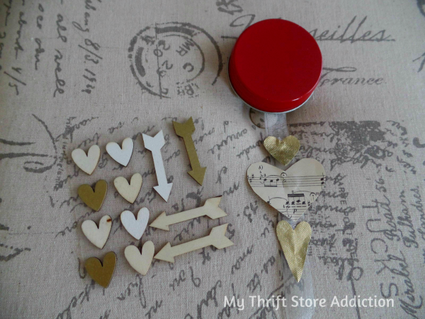 DIY Floating Hearts and Arrow Snow Globe mythriftstoreaddiction.blogspot.com  Valentine snow globe created with vintage sheet music hearts and gold wooden arrow.