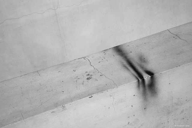 A Minimalist Photograph of Burn Stains on a Wall.