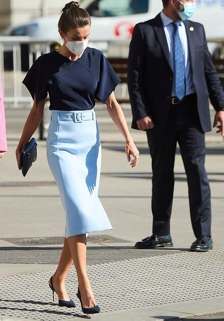 Queen Letizia wore a v-neck pure silk flared sleeves navy blue top and a sky-blue high waisted pencil skirt from Hugo Boss
