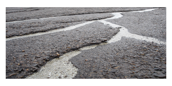 General Writing Task 1 (Damaged Road In-front of your House)