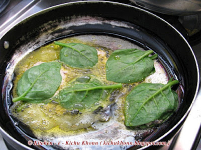 Malabar spinach leaves stuffed with poppy seeds paste