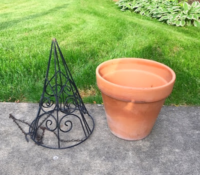 metal planter clay pot green grass patio