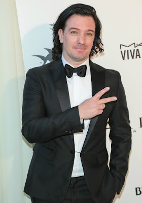 JC Chasez posing for a photo in an award function