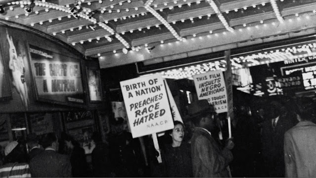 NAACP members picketing outside the Republic Theatre in New York, 1947