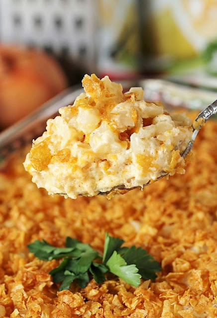 Serving Spoon of Easy Cheesy Potatoes Image