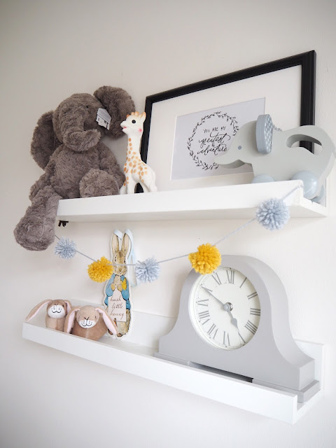 Gender neutral nursery room for a new baby boy or girl, in colour scheme grey and yellow featuring handmade accessories and interiors
