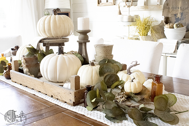 neutral fall tablescape decor, Fall dining room decor, fall table setting. Neutral fall centerpiece. Farmhouse fall dining room. Amber vase, amber bottles
