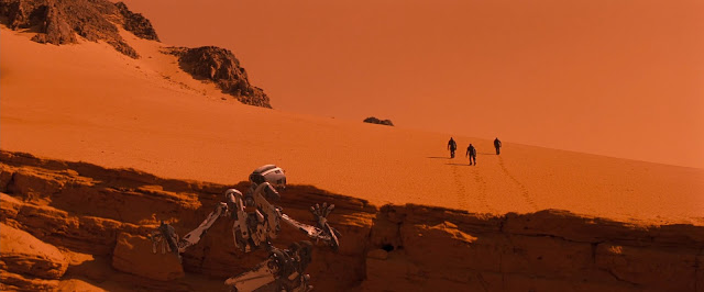 Robot Amme watching astronauts from Red Planet movie