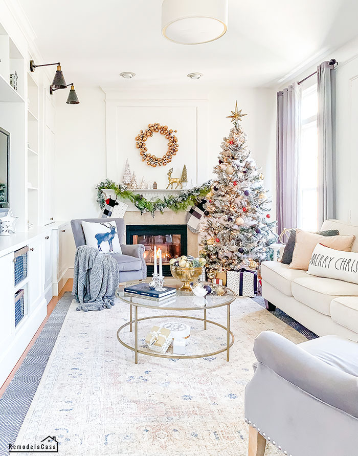 Black and gold pops of holiday decor in family room