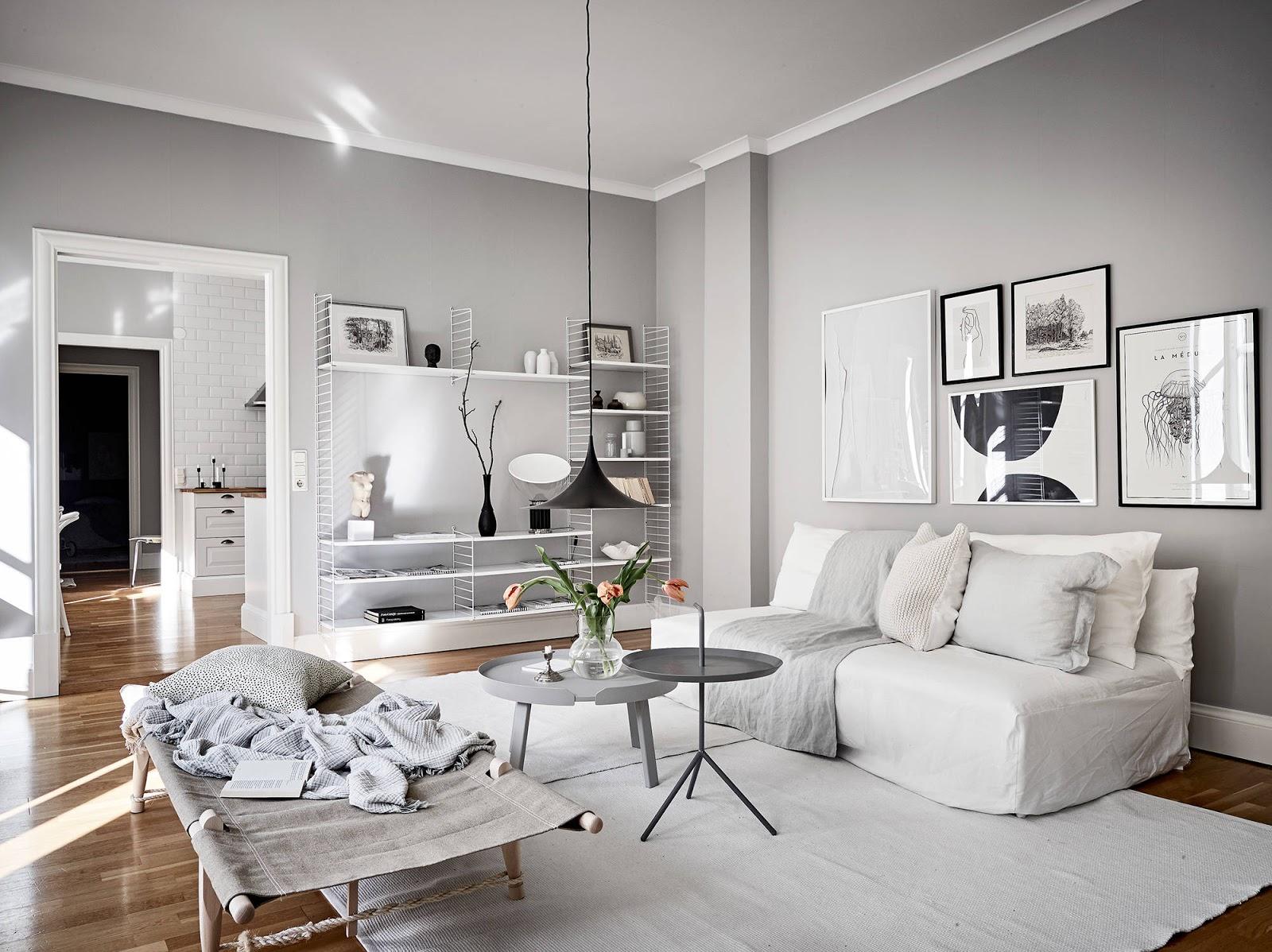 Appartamento con pareti grigie e arredi bianchi arc art for Pareti grigie soggiorno