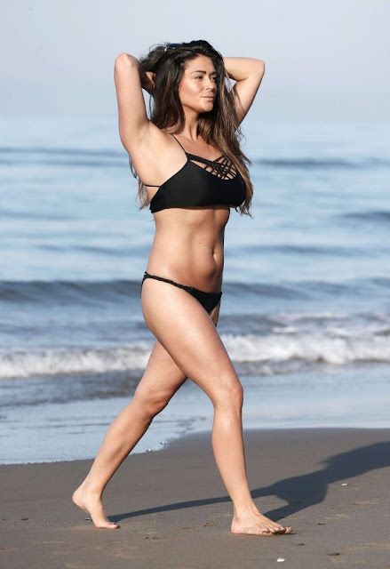 Casey Batchelor in Black Bikini on a beach in Marbella