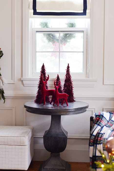 Living room decorated for Christmas with red and white Christmas tree. Canadian Tire mulberry collection Christmas ornaments. Red velvet Christmas decorations