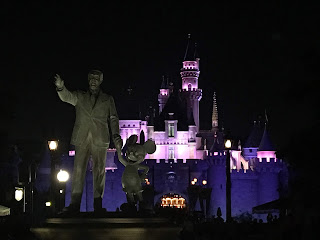 Partners Statue at Night with Sleeping Beauty Castle in the Background