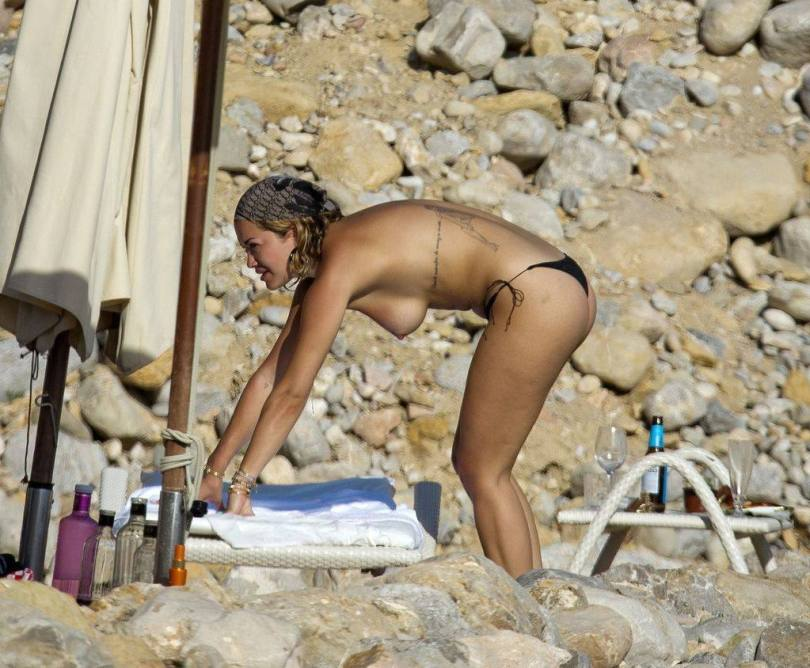 Rita Ora goes topless on Spanish getaway with pals