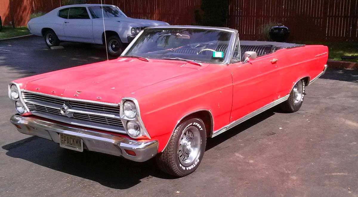 This particular fairlane 500 is wearing a faded coat of red paint and will need some attention paid to rust issues popping up from the hard days of an east