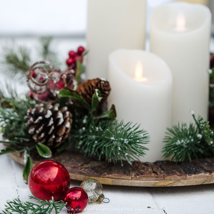 Create a beautiful Christmas vignette in less than 5 minutes with a charger plate, candles, and garland.  |  www.andersonandgrant.com