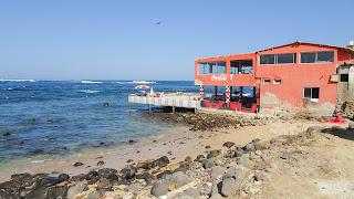 Is an ugly beach with run down restaurants