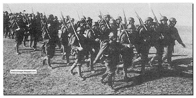 History in images pictures of war history ww2 japanese invasion japanese soldiers on the march in manchuria 1932 the japanese invasion of manchuria began on september 19 1931 when manchuria was invaded by the publicscrutiny Choice Image