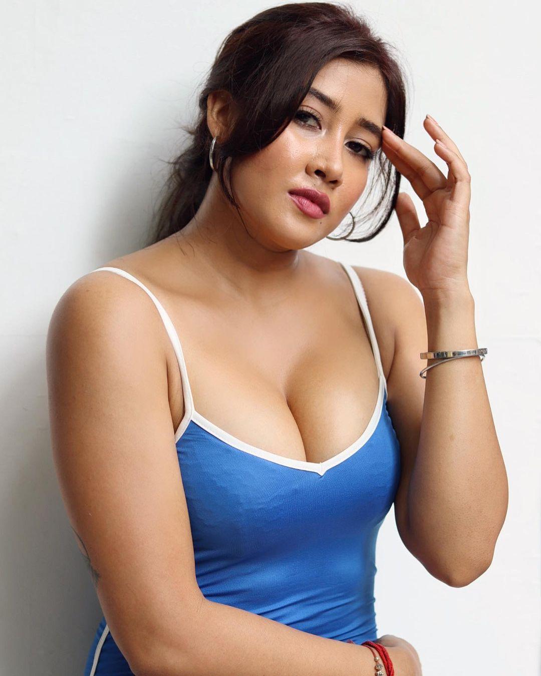 Sofia Ansari in blue top