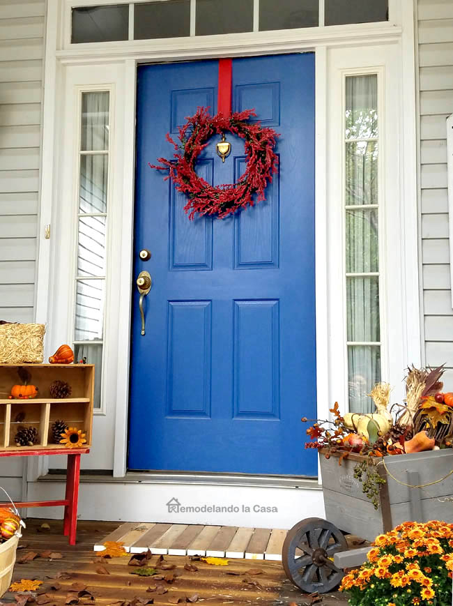 BLUE door, pine cone display, mums, pumpkins