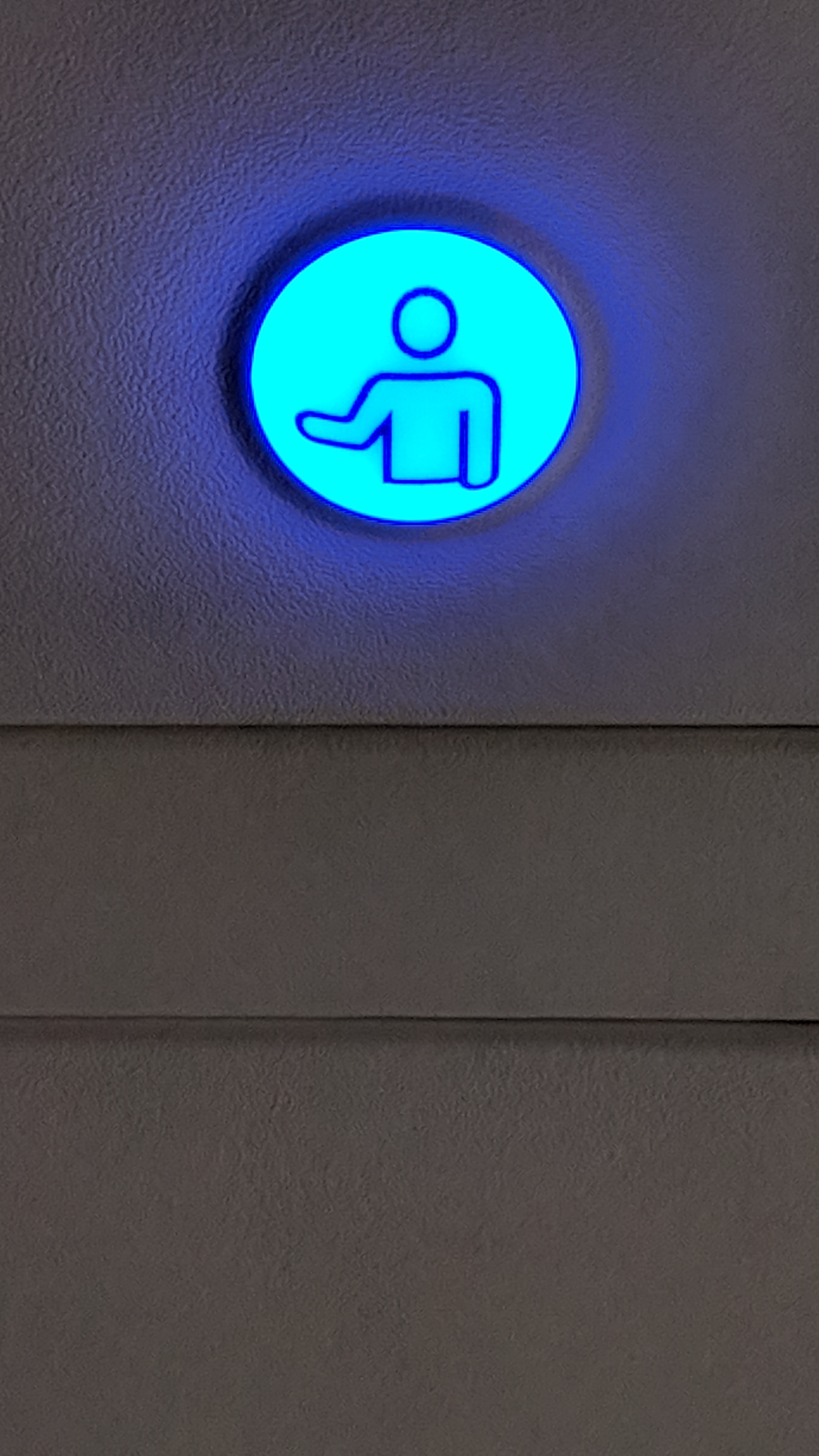 Blue airplane assistant call button
