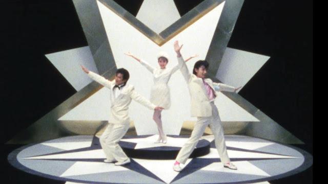two japanese men dancing