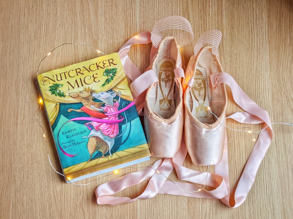 Children's novel Nutcracker Mice by Kristin Kladstrup, fairy lights, and pointe shoes.