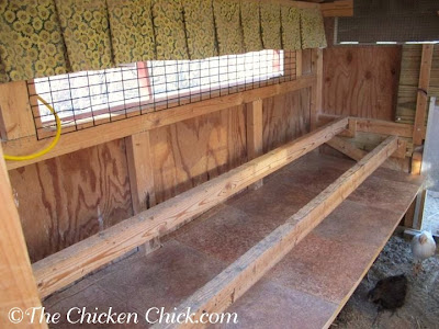 Droppings boards inside the chicken coop help eliminate a major source of humidity inside the coop daily.