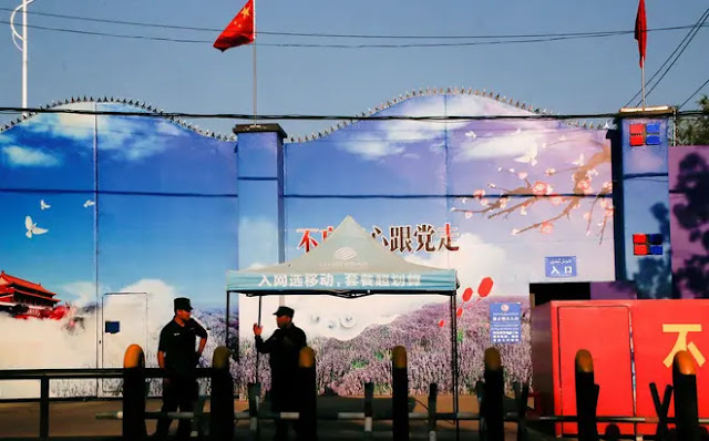 """Guards guard what China calls a """"vocational training center"""" in Xinjiang. Photo: Reuters"""